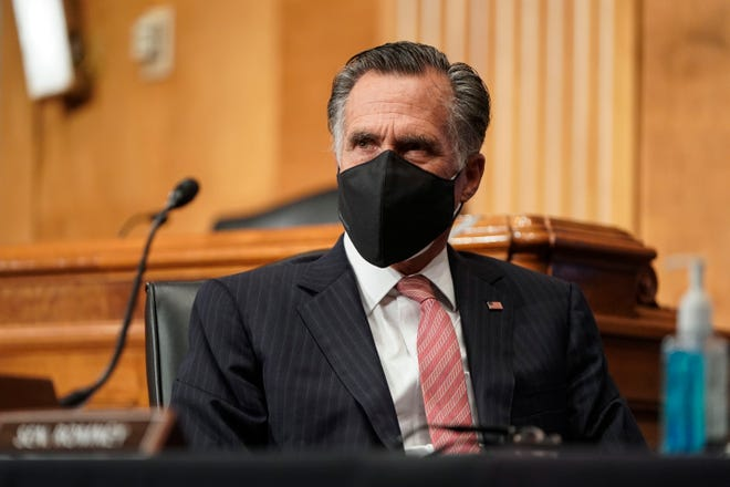 Sen. Mitt Romney (R-UT) wears two protective masks while questioning Alejandro Mayorkas, nominee to be Secretary of Homeland Security, during a Senate Homeland Security and Governmental Affairs confirmation hearing on Capitol Hill on Jan. 19, 2021 in Washington, DC.