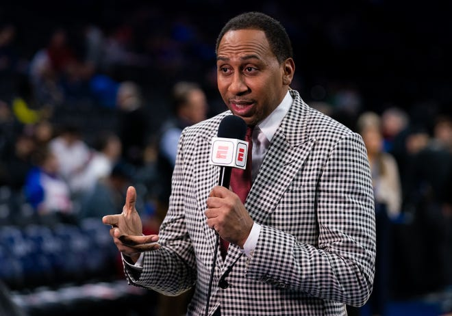 ESPN analyst Stephen A. Smith broadcasts before a game between the Philadelphia 76ers and the Miami Heat at Wells Fargo Center.