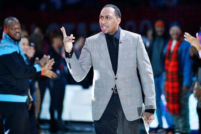 Stephen A. Smith gestures during lineup introductions before the NBA All Star-Celebrity Game at Wintrust Arena.