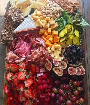 Marissa Fisk, a caterer who posts on Instagram as @modernmomchef, has been making these beautiful cheese-and-charcuterie boards for clients.