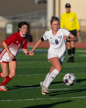 Liberty Hill's Emma Stephens pushes the ball upfield as Belton's Sara Navarro tries to defend during the teams' 0-0 draw at the Governor's Cup soccer tournament on Jan. 16. Stephens notched three goals and three assists in tournament play.