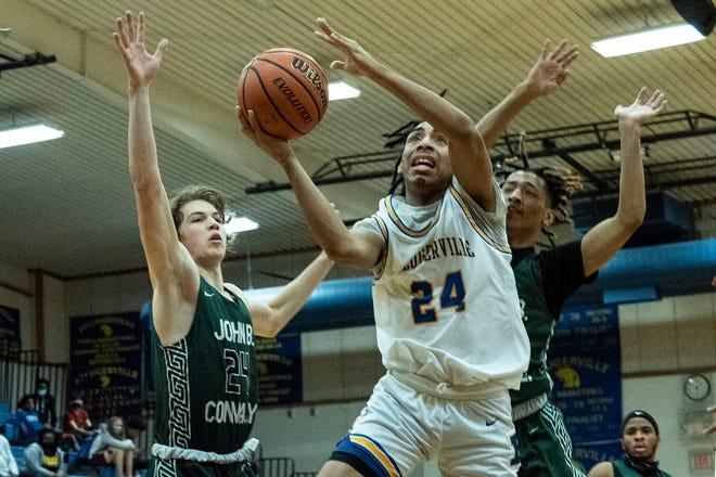 """Pflugerville's TJ Jones goes to the basket as Connally's Sam Barnwell, left, and Jesse Lane defend during Pflugerville's 53-36 win Thursday, at Pflugerville High School. Jones, who usually wears No. 4, donned a No. 24 jersey in honor of Kobe Bryant on the first anniversary of the NBA legend's death. """"This was for Kobe,"""" said Jones, who scored a game-high 17 points on 6-of-8 shooting from the floor."""