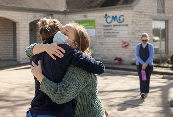 Dr. Katie Sanford, left, and nurse Kristina Shira console each other at Children's Medical Group on Jan. 27, the day after Dr. Katherine Lindley Dodson was slain there. Austin this year has already seen its largest number of homicides in three decades.