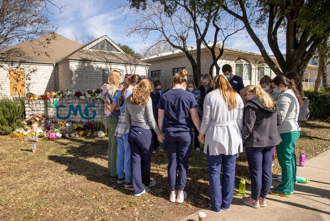 Doctors and nurses from Pediatrics Associates of Austin gather at a memorial to pay their respects to slain pediatrician Lindley Dodson at Children's Medical Group on West 35th Street in Central Austin on Jan. 27.