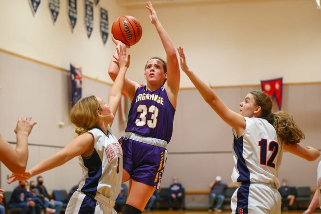 La Grange forward Megan Brothers puts up a shot in traffic against Round Rock Christian in the second half of a nondistrict game Jan. 26 at Round Rock Christian Academy. La Grange pulled away from RRCA by a final of 72-35.