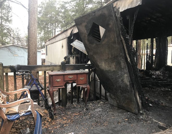 Three people died when this home burned Wednesday morning at Hallmark Mobile Home Park in Athens. [Wayne Ford/Athens Banner-Herald]