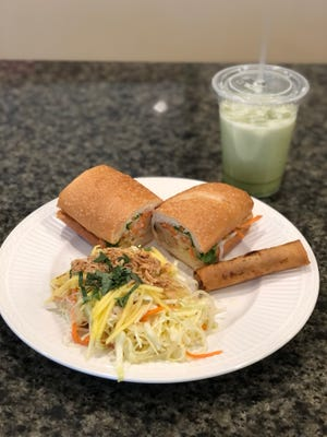 Lemongrass chicken banh mi with a Vietnamese eggroll, Vietnamese salad and matcha latte, from Evelyn's Coffee & Banh Mi in downtown Akron.