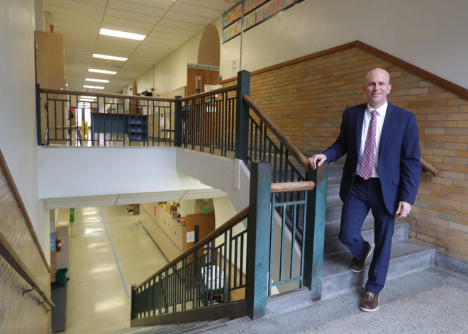 Hudson City School District Superintendent Phil Herman is pictured at the former Hudson Middle School building on North Oviatt Street on Monday, Jan. 25, 2021. The district will host a community webinar meeting at 7 p.m. on Feb. 1 to discuss a housing development that has been proposed for the building. [Phil Masturzo/ Beacon Journal]