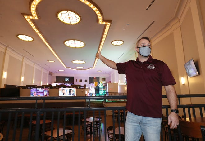 Tim Frankish, a co-owner of The Workz, a new restaurant/bar/arcade/entertainment center opening at the site of the former Falls Theater, talks about the restoration of the ceiling to its original splendor during recent a tour of the new facility in Cuyahoga Falls.