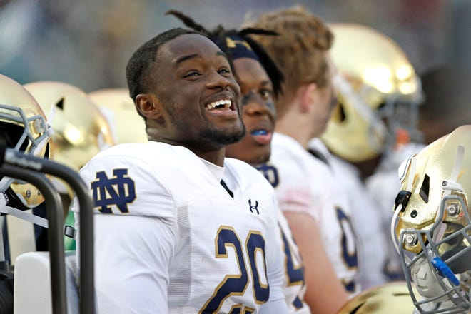 Nov 30, 2019; Stanford, CA, USA; Notre Dame Fighting Irish defensive lineman Ovie Oghoufo (29) sits on the bench during the fourth quarter against the Stanford Cardinal at Stanford Stadium. Mandatory Credit: Darren Yamashita-USA TODAY Sports