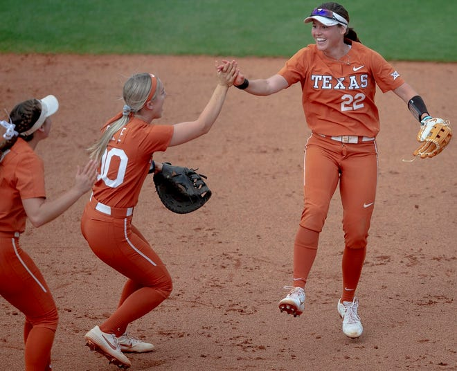 Texas outfielder MK Tedder (22) celebrates with infielder Lauren Burke (00) during a postseason game against Sam Houston State on May 17, 2019 in Austin.