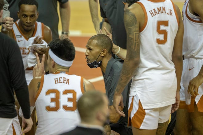Texas assistant coach K.T. Turner coached the Longhorns in Tuesday night's home loss to Oklahoma because UT head coach Shaka Smart has tested positive for COVID-19.