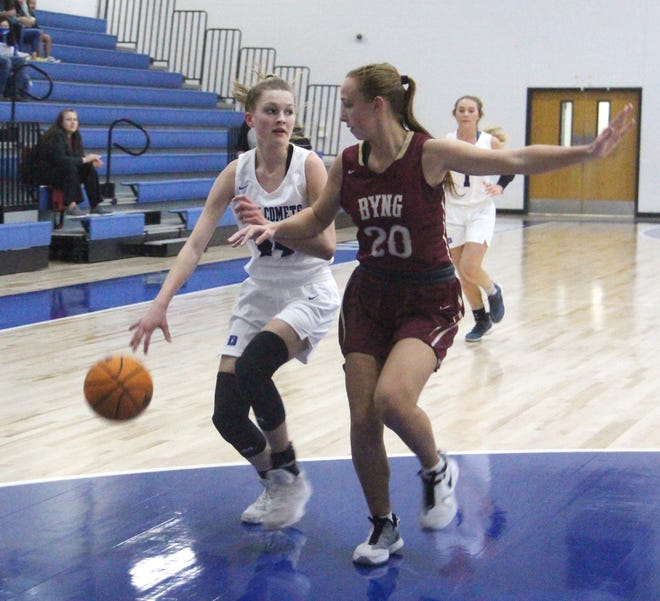 Dickson's Marya Southerland looks for an open teammate Tuesday night against Byng. The freshman led the Lady Comets with eight points.