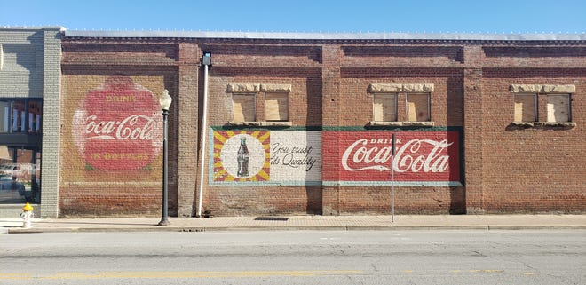 Two vintage advertisements for Coca-Cola were uncovered over the weekend during the ongoing renovation process at Cook Paint. Building owner Todd Graves said he plans to keep the murals, which were signed by the artist in 1967, in place.