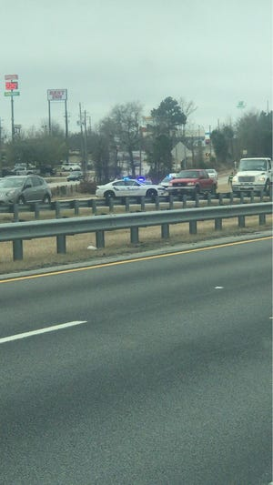 The shooting occurred on I-20 eastbound around mile marker 194. Two were injured and one was arrested.