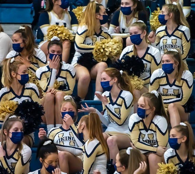 Hopewell cheerleaders wear their masks during the Vikings game against Blackhawk earlier this season.