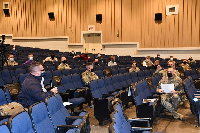 During the question-and-answer session at the Joint Readiness Training Center and Fort Polk Medical Evacuation Conference, held Jan. 14, Brig. Gen. David S. Doyle, JRTC and Fort Polk commanding general, talks to Neal Fudge, Governor's Office of Homeland Security and Emergency Preparedness, assistant deputy director, about the information provided at the conference.