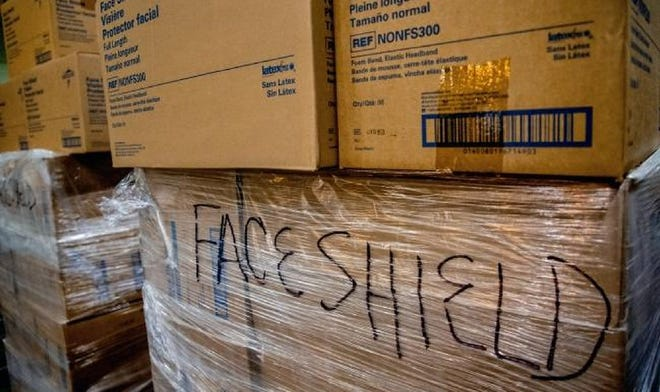 In this April 2020 photo, boxes of personal protection equipment (PPE) and medical supplies are shown in an Oklahoma City warehouse where the State of Oklahoma amassed a stockpile for its COVID-19 response.