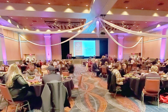 Business owners, friends of the Chamber, and invited guests gather in the Ballroom of the Isle of Capri Casino Hotel on Friday, January 22, 2021, for a review of 2020 activities, Board and officer installation, and the presentation of its annual awards described [above/below].