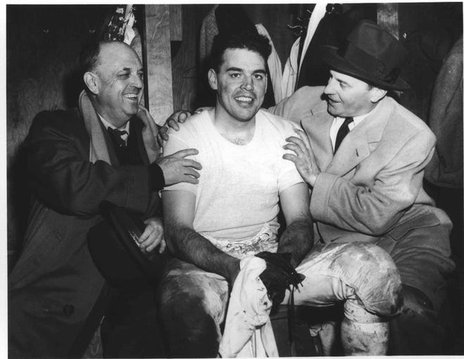 Paul Brown, right, was a highly successful pro football coach because of his organization skills, according to the late Otto Graham, his star quarterback on early Cleveland Browns teams. In this 1954 photo, Graham and Brown celebrate the Browns' NFL championship victory over Detroit with Graham's father, Otto Sr.