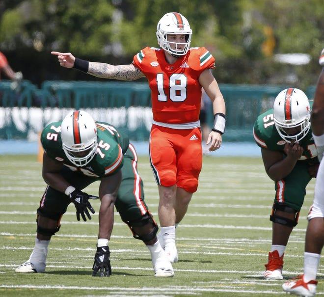 Miami quarterback Tate Martell (18) signals during the Miami Hurricanes Spring scrimmage at Traz Powell Stadium in Miami on Saturday, April 13, 2019. (Al Diaz/Miami Herald/TNS)