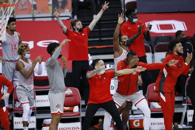 The Ohio State bench celebrates a three-pointer by Duane Washington Jr. during a game against Purdue Boilermakers at Value City Arena on Jan. 19. ESPN's Joe Lunardi lists the Buckeyes as the fourth No. 1 seed and one of 10 Big Ten teams to make the NCAA tournament.