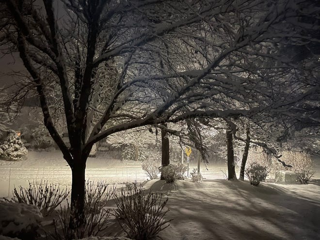 Snow covers the ground in Southport in Mashpee on Tuesday night.