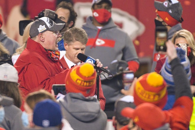 Kansas City Chiefs head coach Andy Reid gives an interview, with Chiefs owner Lamar Hunt to his left, after beating the Buffalo Bills in the AFC championship game Sunday in Kansas City.