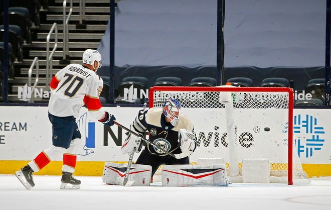 Patric Hornqvist (70) scores the deciding goal of the Florida Panthers' 4-3 shootout win Tuesday against the Blue Jackets, beating goalie Joonas Korpisalo (70) to the far side of the net.