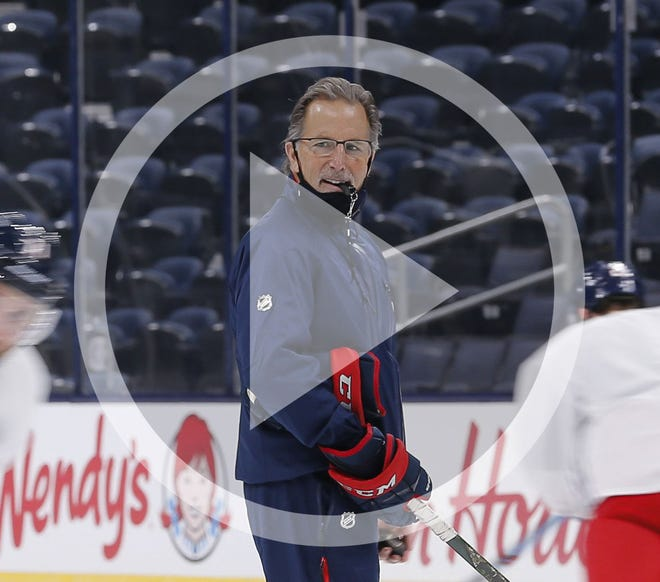 In this file photo, Columbus Blue Jackets head coach John Tortorella holds a stop watch as he runs players through skating conditioning during training camp at Nationwide Arena in Columbus on Tuesday, Jan. 5, 2021.