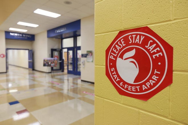 Signs will direct children at East Linden Elementary, which will be one of the Columbus City Schools to be reopened Monday after the COVID-19 restrictions caused the entire district to stop in-person teaching in spring 2020.