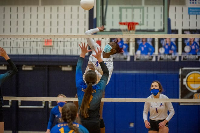 Asheboro's Diamond McDowell goes up for the spike against Southwestern Randolph in a cross town rivalry match on Jan. 5. McDowell has been named co-player of the year in the Mid-Piedmont Conference. [PJ WARD-BROWN FOR THE COURIER-TRIBUNE]