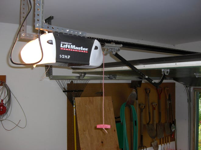 This garage door opener can last for many years, provided that the springs attached to the door do most of the lifting.