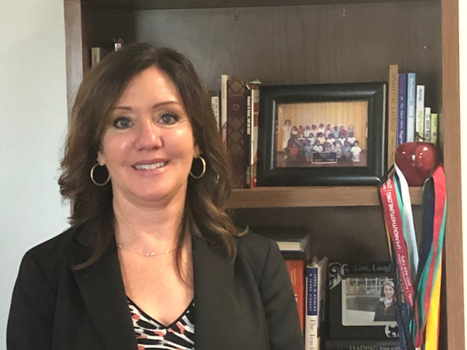 Lake County Schools Superintendent Diane Kornegay is shown in her office in Tavares on Wednesday, Jan. 27, 2021. A picture of her first class is on the top shelf of the bookcase.