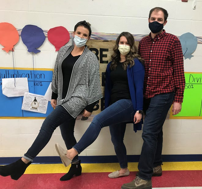 Cambridge Intermediate School teachers, from left, Jen Coulter, Jess Strasser and Gregg Strasser wearing their jeans in support of the jeans week fundraiser for Feed My People.