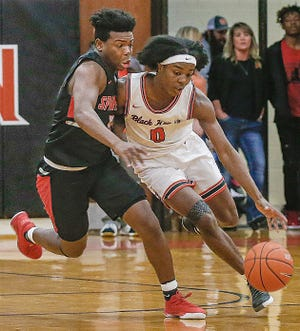 North Davidson's Tedric Jenkins dribbles under heavy defensive pressure by Central Davidson's Lleyton King in a game last season. Jenkins and the Black Knights beat West Davdson on Tuesday to remain undefeated. [MICHAEL COPPLEY FOR THE DISPATCH]