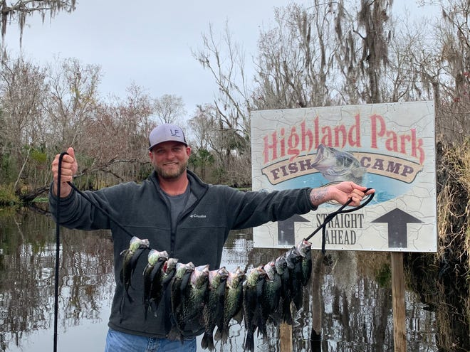 Brandon Stokes of DeLand shows his catch of speckled perch fishing on the Norris Dead River from Highland Park Fish Camp.