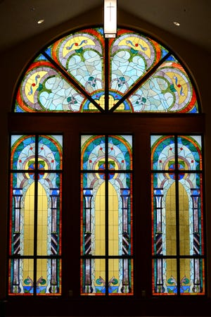 A stained glass window in the chapel of the new First Presbyterian Church of Girard is shown Jan. 27, 2021. The church was destroyed by fire in July 2018.