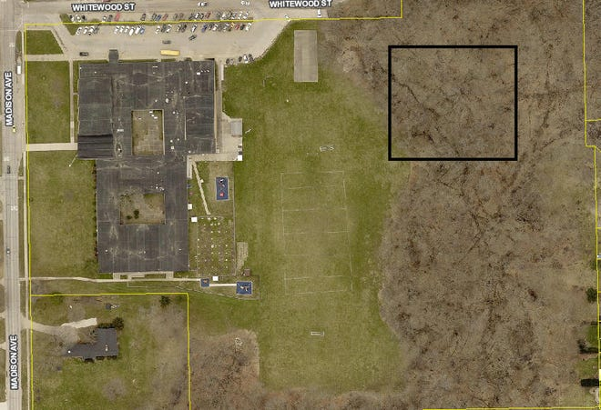 A ariel photograph of James Madison School. The black square shows the approximate location of retention pond the city of Burlington wants to build.