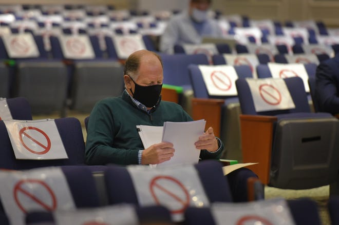 Jacksonville Jaguars president Mark Lamping looks over paperwork at the start of a city council meeting to address the Lot J development agreement on December 3, 2020.