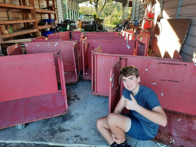 Ben Black with the aging carts belonging to Beaches Emergency Assistance Ministry and its food bank. The local scout updated the carts for his Eagle project while also hosting a food drive and raising money.