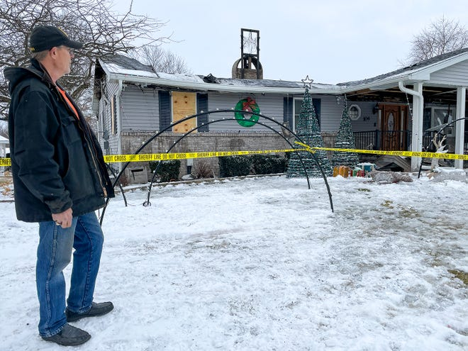 Darrell Corbin looks over the destruction caused by a fire Tuesday night that heavily damaged his 104 Indiana Ave. home in East Galesburg. Corbin and his wife Sandi, who escaped unharmed, are known for their elaborate Christmas and Halloween outdoor displays which drew thousands of visitors, and collected food and cash donations for area food banks.. The home was a total loss.