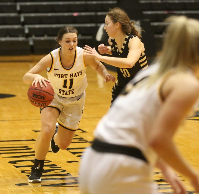 FHSU's Jaden Hobbs looks to dribble around a defender earlier this season against Emporia State. Hobbs is coming off a 26-point, 12-assist outing against Pittsburg State.