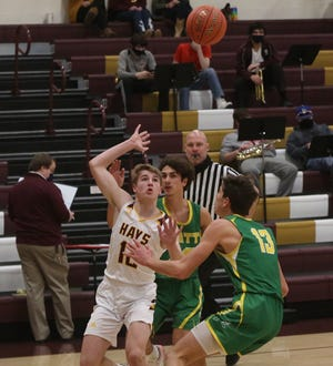 Hays High's Jordan Dale throws a lob pass to T.J. Nunnery during the Indians' 74-29 win over Pratt on Tuesday at HHS.