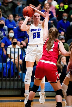 Gunter's Rhyan Pogue, who hit three three-pointers, shoots during the Lady Tigers' victory over Pottsboro in District 11-3A play.