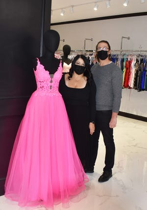 Fatima Rodrigues and Joel Benson, co-owners of Alexandra's Too boutique on South Main Street in Fall River, are ready for prom season.