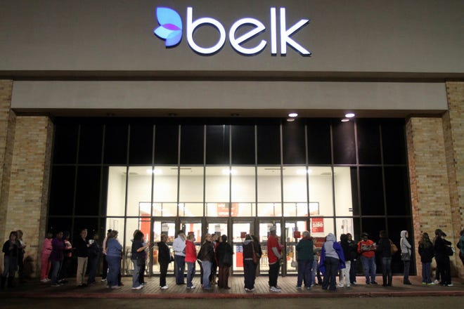 In this Nov. 25, 2011 photo, shoppers line up outside a Belk store in Vicksburg, Miss., early in the morning for their Black Friday sales. Belk, the North Carolina-based department store chain which has catered to generations of shoppers for nearly 190 years, announced Tuesday that it will file for Chapter 11 bankruptcy. (Eli Baylis/The Vicksburg Post via AP)