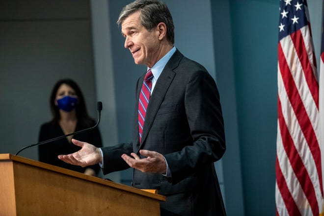 Gov. Roy Cooper speaks during a briefing on North Carolina's coronavirus pandemic response Wednesday, Jan. 27, 2021 at the NC Emergency Operations Center in Raleigh. (Travis Long/The News & Observer via AP)
