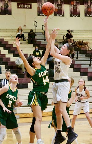 Salina South's Elizabeth Franco (14) attempts to block Buhler's Mallory Hanen (23) during their game Tuesday evening. Salina South defeated Buhler 41-32.