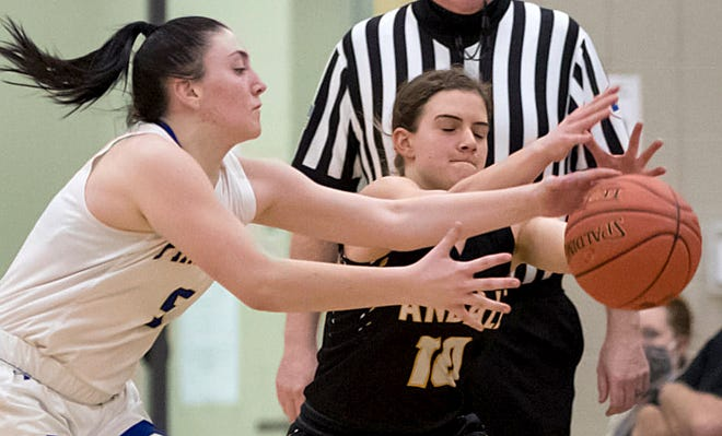 Nickerson's Josie McLean (5) grabs the ball away from Andale's Kelli Wegerer (10) during their game at the Wildcat Classic Basketball Tournament in Haven Tuesday night. Andale defeated Nickerson 39-34 in overtime.